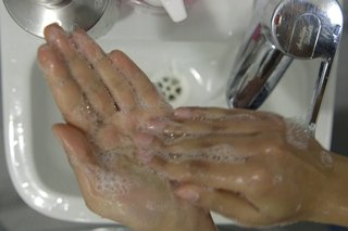 image of cleaning left palm over the sink